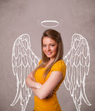Cute girl with angel illustrated wings Royalty Free Stock Images