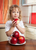 Cute girl with apple Stock Images