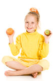 Cute girl with an apple and kiwi Royalty Free Stock Image