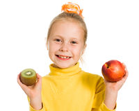 Cute girl with an apple and kiwi Royalty Free Stock Images