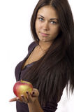 Cute girl with an apple in your hands Stock Image