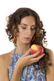 Cute girl with an apple in your hands Stock Photos