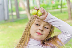 Cute girl with apples Royalty Free Stock Photography