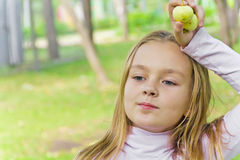 Cute girl with apples Royalty Free Stock Image