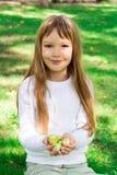 Cute girl with apples stock photos