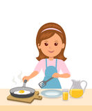 Cute girl in an apron prepares an omelet. Mom to cook breakfast. Concept design of motherhood and household chores Stock Photography