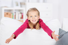 Cute Girl With Arms Out At Home Royalty Free Stock Photography