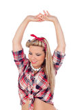 Cute girl with arms up in pinup style Stock Photos