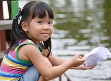 Cute girl Asian like to feed the fish Stock Photos