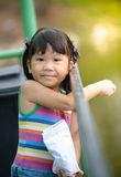 Cute girl Asian like to feed the fish Stock Photography