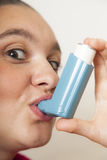 Cute girl with asthma inhalator Royalty Free Stock Image
