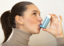 Cute girl with asthma inhalator Royalty Free Stock Photography