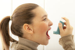Cute girl with asthma inhalator Royalty Free Stock Photo