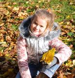 Cute girl in autumn Royalty Free Stock Images