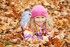 Cute girl at autumn Stock Images