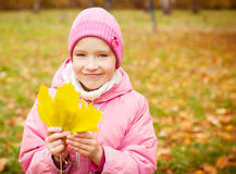 Cute girl at autumn Royalty Free Stock Photos