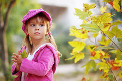 Cute girl in autumn park Stock Photo