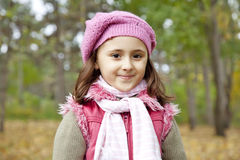 Cute girl in autumn park Royalty Free Stock Photo
