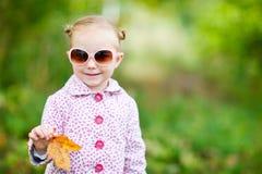 Cute girl in autumn park Stock Photography