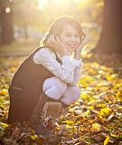 Cute girl in autumn park Royalty Free Stock Photos
