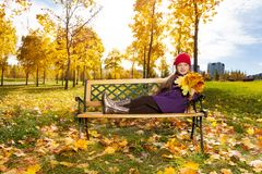 Cute girl in autumn park Stock Photography