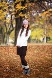 Cute girl in autumn park royalty free stock photos