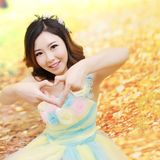 Cute girl and autumn background royalty free stock image