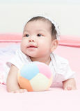 Cute girl baby play ball on pink blanket Stock Photos