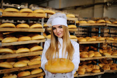Cute girl on the background bakery Royalty Free Stock Photos