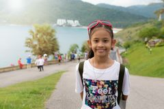 Cute girl with backpack at promthep cape. Royalty Free Stock Photos