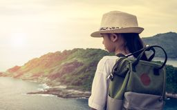 Cute girl with backpack viewing to the sea. Stock Photos