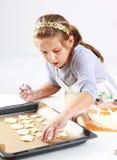 Cute girl baking cookies Royalty Free Stock Photos