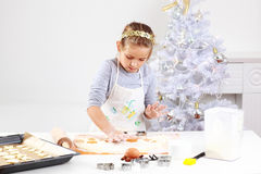 Cute girl baking cookies Royalty Free Stock Photography