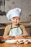 Cute girl baking cookies Royalty Free Stock Photo