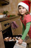 Cute girl baking xmas cookies Stock Photos