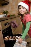 Cute girl baking xmas cookies Stock Photos