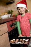 Cute girl baking xmas cookies Royalty Free Stock Image