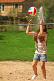 Cute girl with ball near volleyball net Stock Photos