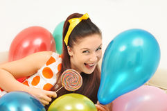 Cute girl among ballons Royalty Free Stock Photography