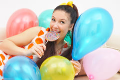 Cute girl among ballons Royalty Free Stock Images