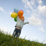 Cute girl with balloons Stock Images