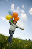 Cute girl with balloons Stock Image