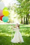 Cute girl with balloons Stock Photo