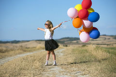 Cute girl with balloons Royalty Free Stock Photography
