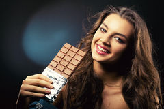 Cute girl with bar of chocolate Royalty Free Stock Photo