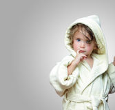 Cute girl in bathrobe portrait. 2 years old Royalty Free Stock Image