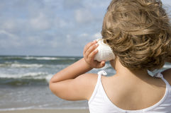 Cute girl on the beach Royalty Free Stock Photography