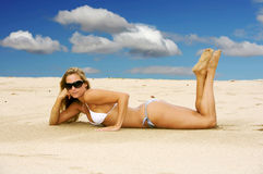 Cute Girl on the Beach. Beautiful blond woman laying on the beach Stock Photos