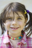 Cute girl with beads smiling Royalty Free Stock Photo