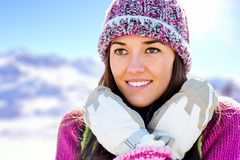Cute girl with beanie and gloves in mountains. Royalty Free Stock Photography